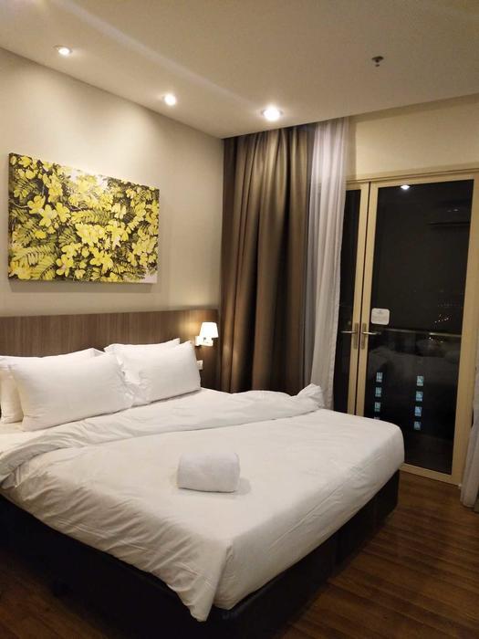美迪尼服务公寓1.8米大床